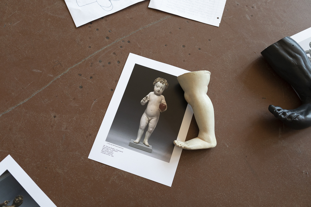 Foot and sculpture of Christ as a Child